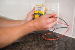 Metering voltage with digital multimeter Stock Image