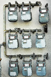 Meters. A bank of nine natural gas meters stock photography