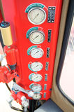 Meters or gauge in crane cabin for measure Maximun load, Engine speed , Hydraulic pressure , Temperature and fuel level Royalty Free Stock Image