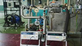Meters show data of pumping equipment in plant workshop