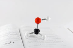 Methanol. A molecule of methanol on a text book royalty free stock image