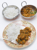 Methi chicken meal with serving bowls Stock Image
