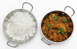 Methi chicken and rice in kadai bowls. Methi murgh - chicken cooked with fresh fenugreek leaves - in a kadai, or karahi, traditional Indian wok, over white Stock Photography