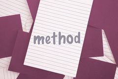 Method against purple paper strewn over notepad Stock Image