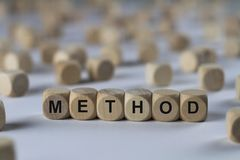 Method - cube with letters, sign with wooden cubes Stock Image