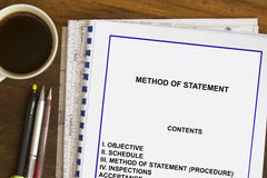 Method of statement. Concept with coffee and documents Stock Photos
