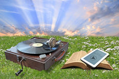 Methods of preaching the gospel. Photo of vintage and modern means of preaching the gospel showing a vintage 1930 phonograph a modern mobile tablet device Royalty Free Stock Image