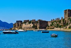 Methoni Castle, Western Peloponnese, Greece. A perfect summer day in Methoni, Western Peloponnese, Greece, with small boats anchored in the bay, the Medieval royalty free stock photos
