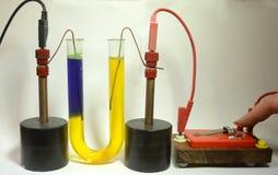 Methylene Orange indicator in salt water. Electrolysis of salt water, with methylene orange added as indicator. The indicator turns blue at the negative stock photography