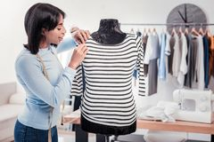 Waist up of experienced designer doing measurements stock photo