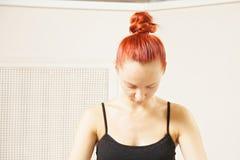 Metitating redhead closeup Royalty Free Stock Photo