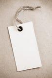 Metki etykietka przy papierową teksturą Obraz Stock