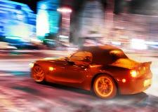 Metrópoli borrosa en la noche Foto de archivo libre de regalías