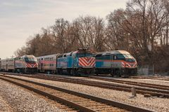 METRA Commuter Trains on Track stock photography