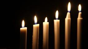 Metragem da vela branca de queimadura Feliz Natal vídeos de arquivo