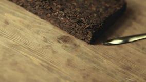 Metraggio di legno del hd della tavola del coltello cinese nero del tè nessuno video d archivio