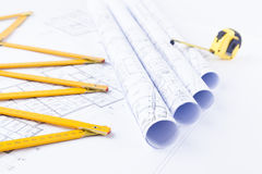 Metric folding ruler and architectural drawings of the modern house Royalty Free Stock Images