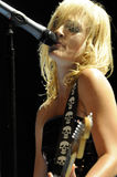 Metric performing live. Emily Haines of Metric performing live at Greek Theatre in LA in September 2009 Stock Photos