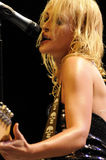 Metric performing live. Emily Haines of Metric performing live at Greek Theatre in LA in September 2009 Stock Photo