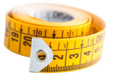 Metric tape. Isolated yellow metric tape on white background Royalty Free Stock Photos