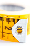 Metric tape closed-up. Closed-up of yellow metric tape on white background Royalty Free Stock Photo