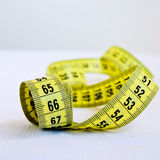 Metric tape measure on white background Stock Photo