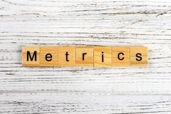 METRICS word made with wooden blocks concept.  Stock Images