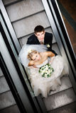 In metro. Bride and groom in metro royalty free stock photos