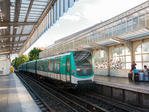 Metro arriving at a station in Paris Royalty Free Stock Images