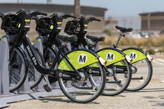 Metro BIkes parked in Metro racks. LOS ANGELES, CA - JULY 25, 2018: Metro plans to expand its bike share program utilizing new Smart Bikes in several new royalty free stock images