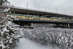 Metro bridge across the Moscow River. Metro and auto bridge Luzhniki across the Moscow River. View from the snow-covered Luzhnetskaya embankment to the Stock Photo