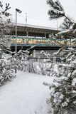 Metro bridge across the Moscow River. Metro and auto bridge Luzhniki across the Moscow River. View from the snow-covered Luzhnetskaya embankment to the Royalty Free Stock Images