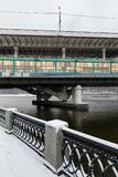 Metro bridge across the Moscow River. Metro and auto bridge Luzhniki across the Moscow River. View from the snow-covered Luzhnetskaya embankment to the Royalty Free Stock Photo