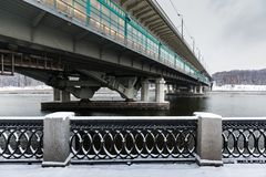 Metro bridge across the Moscow River. View from the snow-covered Luzhnetskaya embankment on the Vorobyovy Gory and the Andreevskaya embankment. The winter city Stock Photo