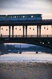 Metro on a bridge in Paris. Metro in Paris (France) crossing River Seine on Bir-Hakeim bridge at sunset stock photo