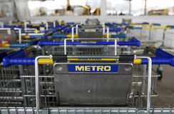 Metro Cash&Carry supermarket logo on carts Stock Photography