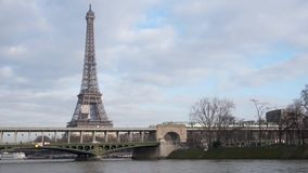Metro crossing Passy bridge. With Eiffel Tower in background - Paris, France stock video