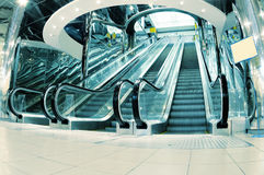Metro escalator. Long modern metro station escalator stock photos