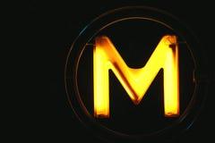 Metro iluminado amarelo de Paris Imagens de Stock