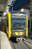 Metro light rail train. Makes a quick stop at a station in Downtown Los Angeles Stock Photos