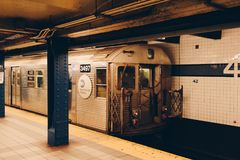 Metro line of the New York City subway. Metro station showing an ancient metallic car arriving at the platform Stock Photo