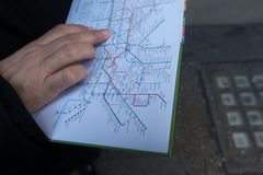 Metro map. Close up view of a hand holding a metro map royalty free stock photography
