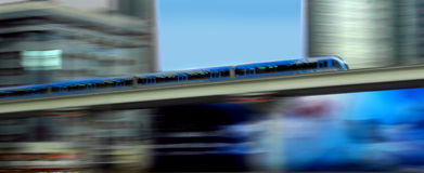 Metro in motion. New metro motion in dubai passing office buildings stock images
