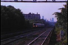 Metro North train traveling through Forest Hills, New York stock footage