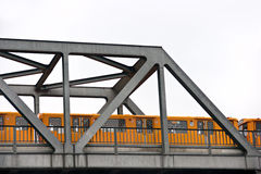 Metro over the bridge, Berlin, Germany. Yellow Metro over the bridge, Berlin, Germany. Isolated on white Royalty Free Stock Photography