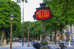 Metro in Paris. PARIS, FRANCE - MAY 11, 2015: This is one of the entrance signs to the Paris Metro royalty free stock image