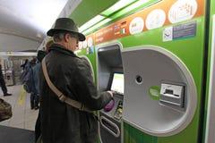 Metro in Paris. People buy tickets in terminal. Paris metro. November 2014 stock photo
