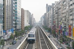 A metro passing by the Daan District. Taipei, DEC 19: A metro passing by the Daan District on DEC 19, 2018 at Taipei, Taiwan royalty free stock photography