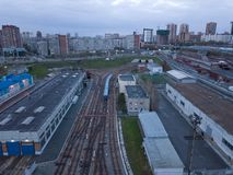 Metro railway depot in Novosibirsk, Russia. With a lot of rails going to the shed stock photos