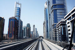 Metro railway in Dubai city. Metro railway line receding through center of Dubai city, United Arab Emirates Stock Image